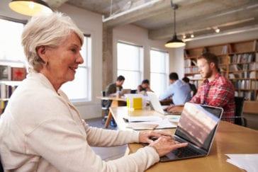 Senior Woman Doing Research on Laptop